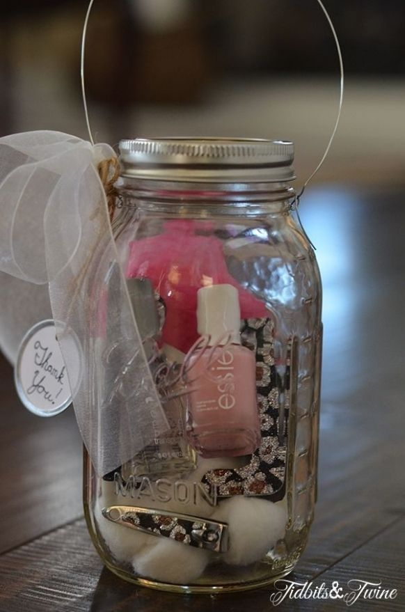 A mason jar, nail polish, nail clippers, nail file, cotton balls, travel sized nail remover, fake nails, finger holder.
