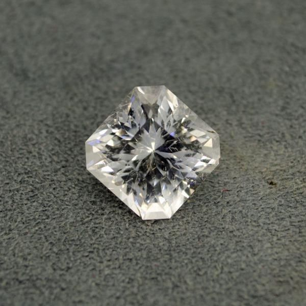 "10.07ct Danburite, 12.32x12.22x9.61mm, near eye clean, untreated, Madagascar, cut by Eric Hoffman in ""Squartuguese"" by Marco Voltolini."