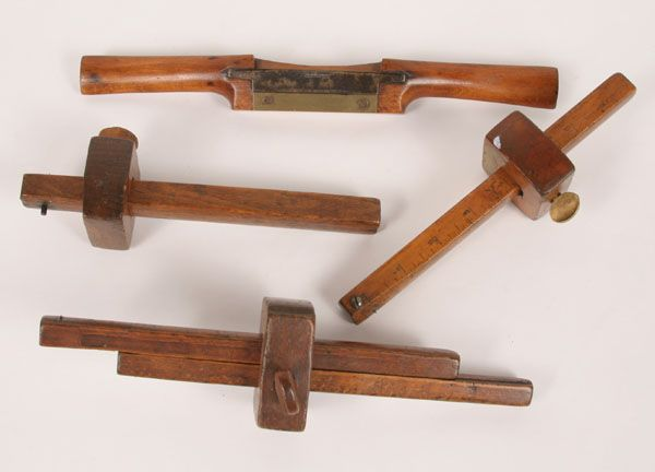 wood tools. lot of four antique treen wooden tools including a wood plane and marking devices with