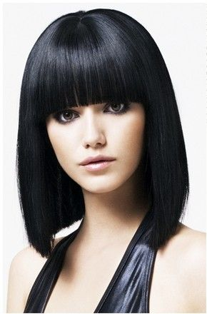 Medium Length Hairstyles With Straight Cut And Neat Thick Bangs