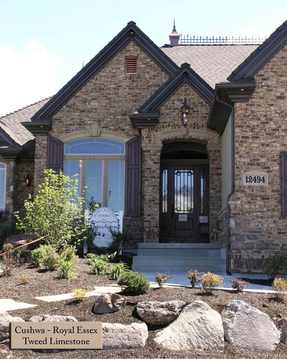 Dark trim stone corners with brick windows exterior for Exterior stone for homes