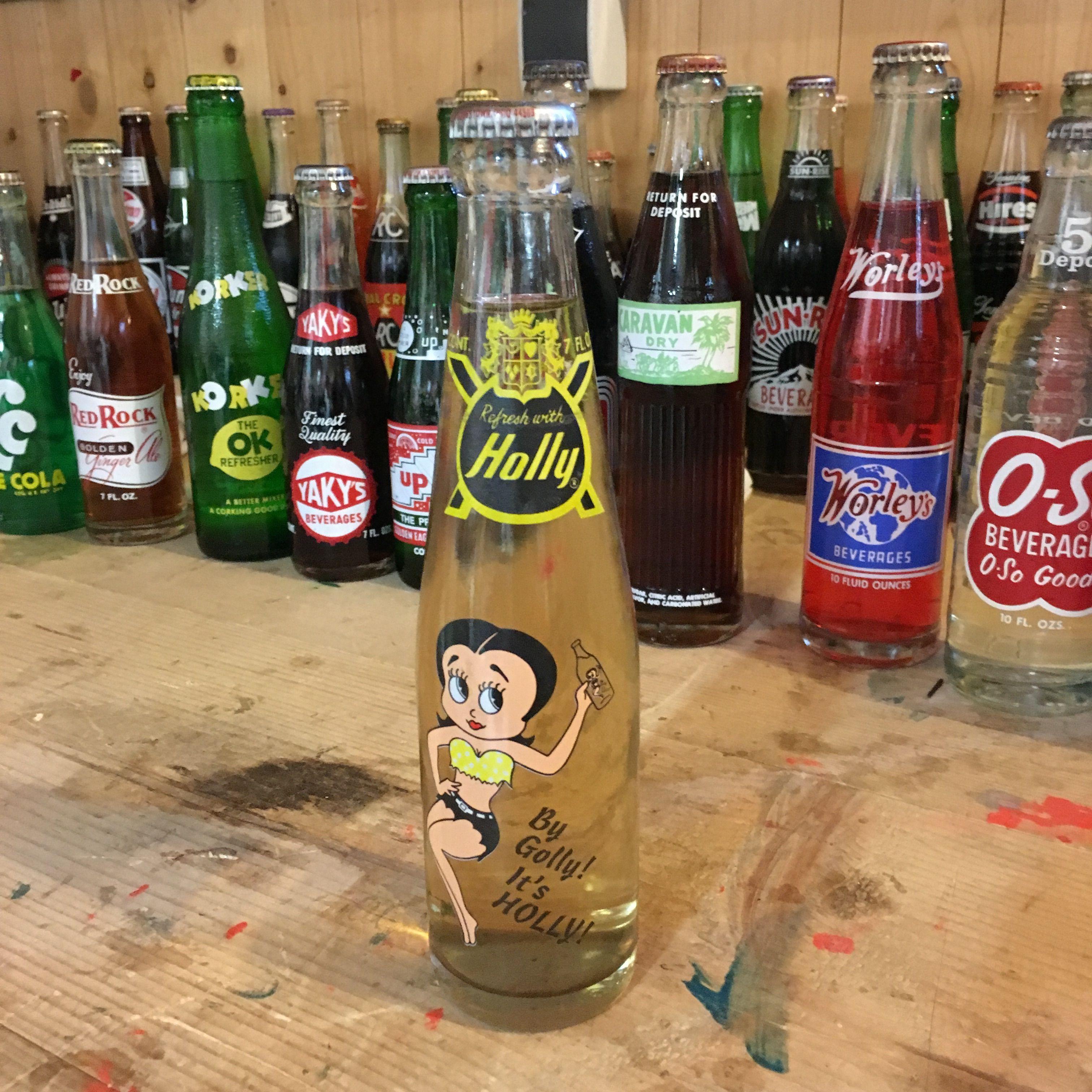 Vintage Holly soda bottle full