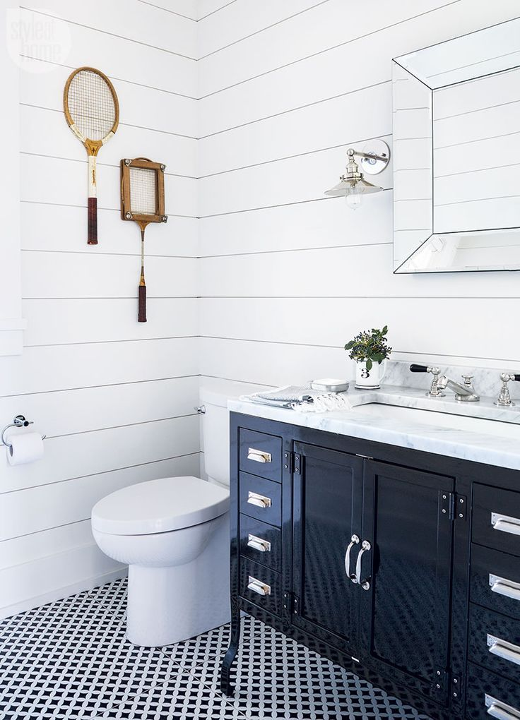 Lovely This cottage bathroom features vintage racquets as artwork PHOTO Robin Stubbert Elegant - farmhouse bathroom designs Simple Elegant