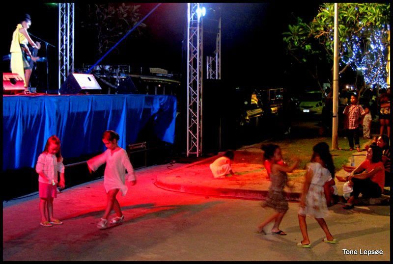 Children dancing in front of the festivaldancers in Kata beach, Phuket, Thailand.  TONE LEPSØES PICTURES