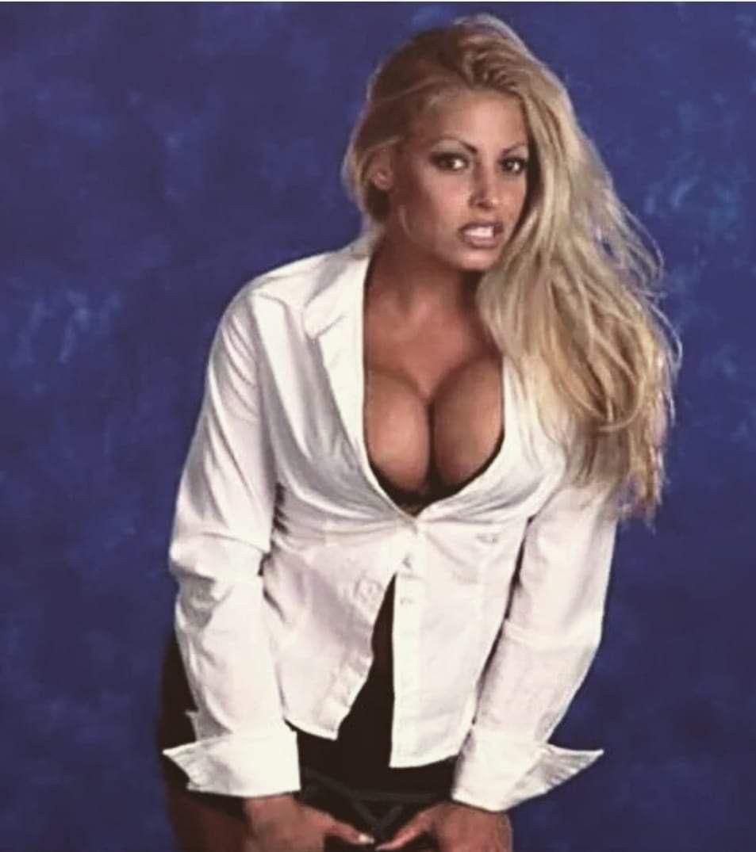 Trish Stratus from The WWE Attitude Era. Holding the
