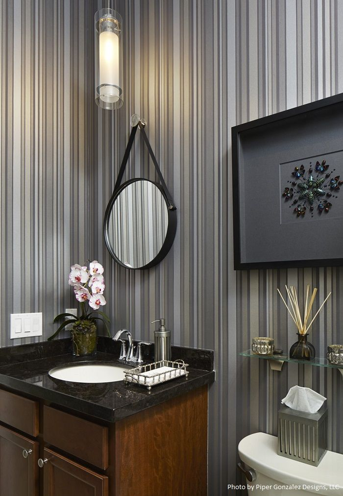 This Cozy Powder Room Has Hanging Pendant Lighting Vertical Striped Wall Treatment And A Black Granite Countertop