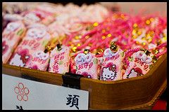 Kitty-chan omamori (Eric Flexyourhead) Tags: pink cute japan gold kyoto bokeh vibrant hellokitty vivid sanrio  colourful shinto kansai nishikimarket kittychan omamori     nishikiichiba  sigmaaf30mmf14exdchsm nishikitenmangushrine olympuse3