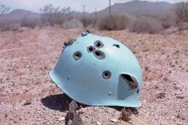 Image result for un helmet bullet holes