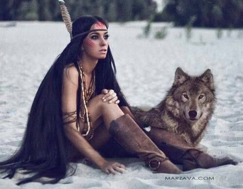 Native American girl with her pet wolf