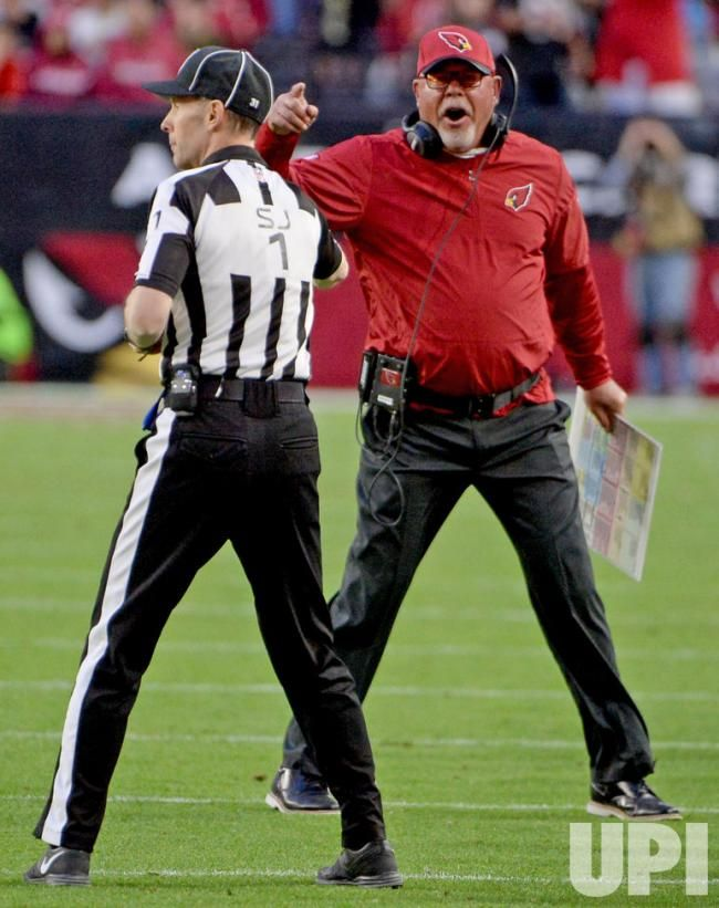 Arizona Cardinals' head coach Bruce Arians (R) gives Side Judge Scott Novak an ear full after a roughing the passer penalty in the fourth…