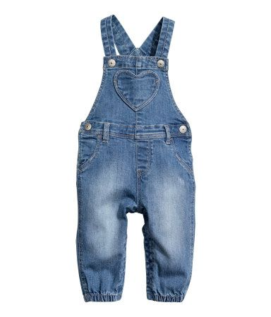 Denim blue. Bib overalls in soft, washed denim with slightly distressed details…
