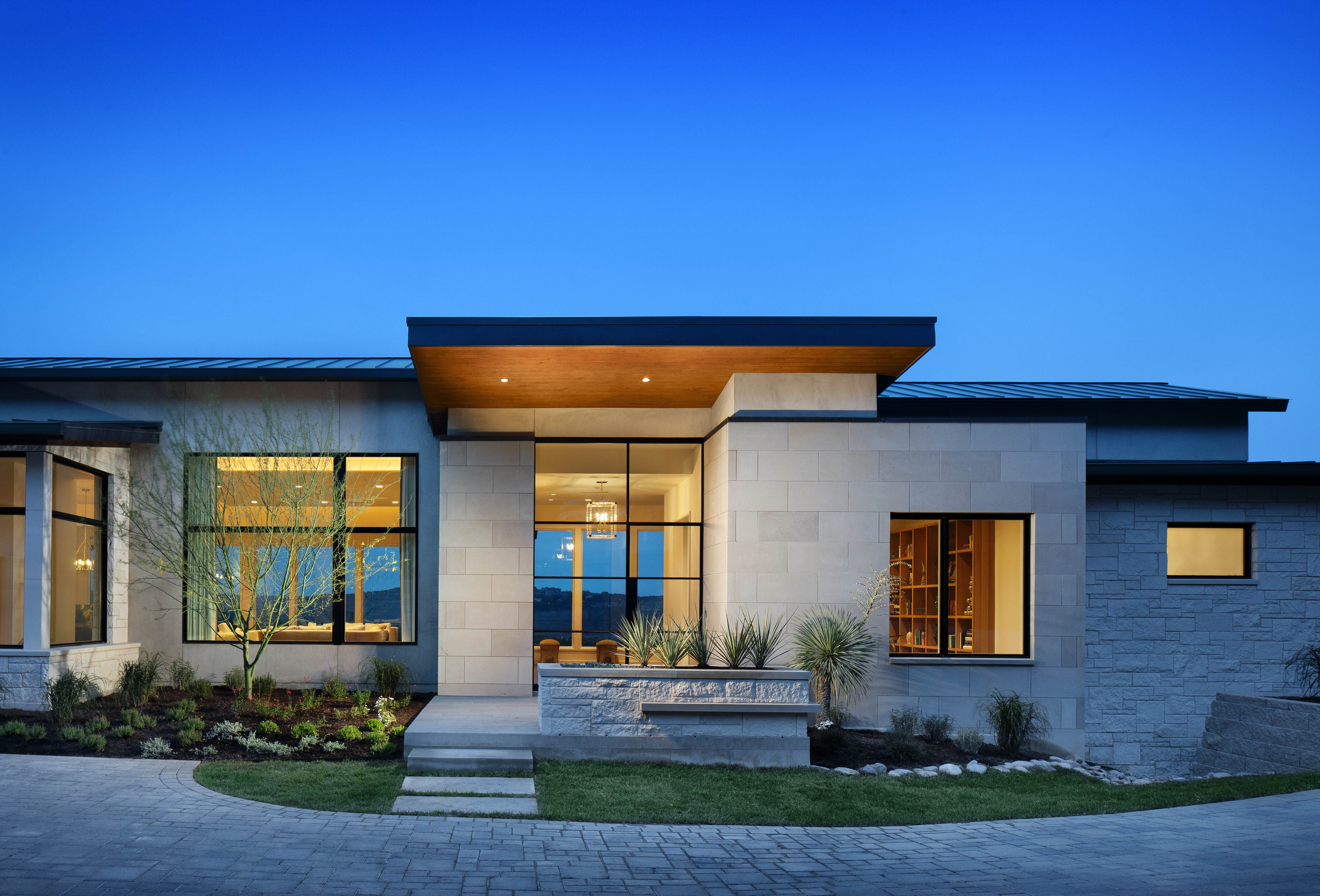 Dark steel roof w uplit straight roof entry lighting contemporary home in austin by james d larue architecture