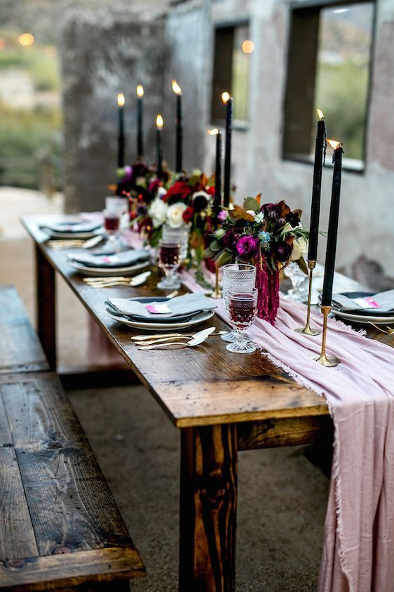 pastel colored wedding tablescape with a powder pink table runner and blue napkins jewel tone