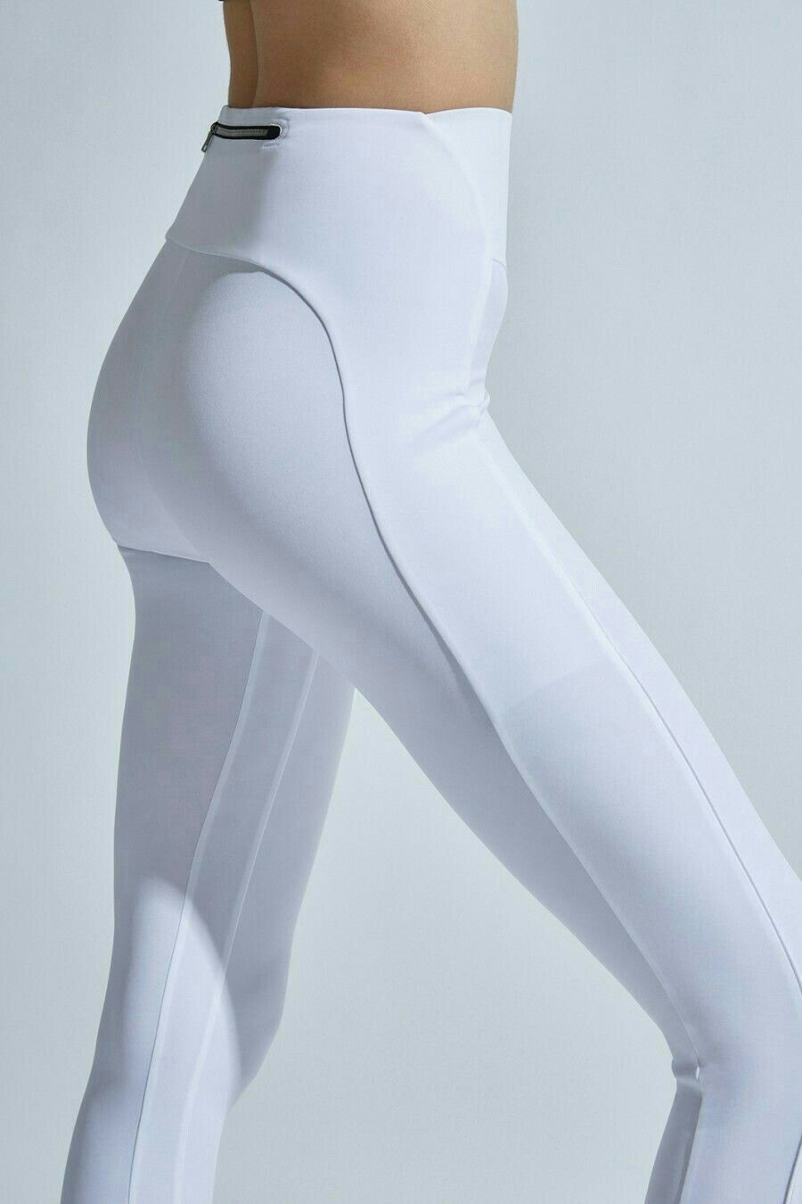 94e5bb28e3111 A high-rise legging featuring curve-enhancing details. Small zipper at side.