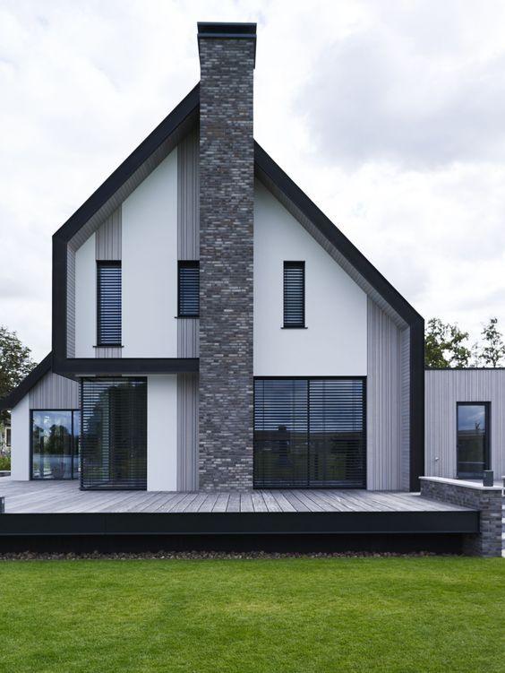 Een nieuwe villa aan het water stucwerk cederhout for Interieur villa design