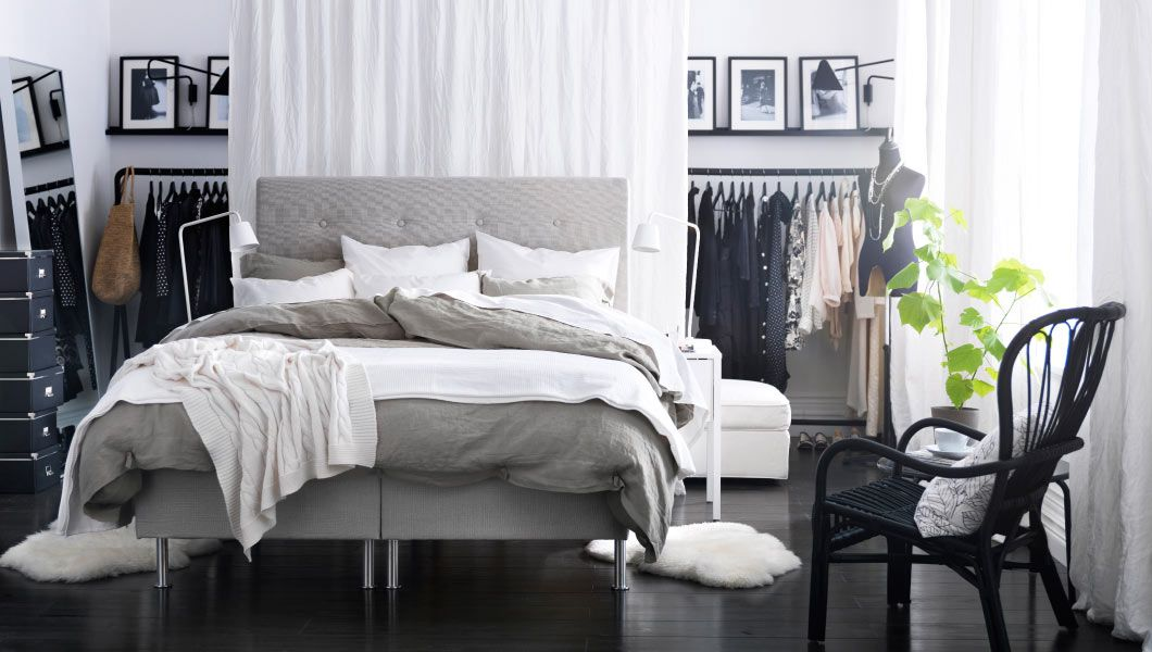 Cosy bedroom with open clothes storage