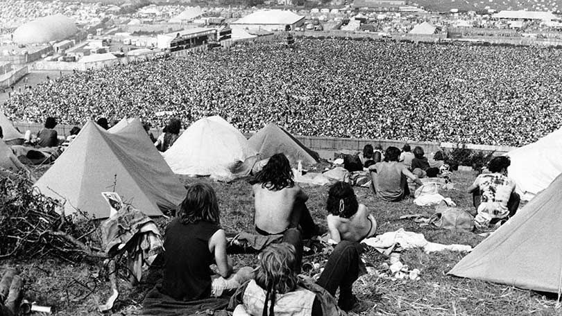 Fans Watching From The Hill Outside The Arena Isle Of White Festival In 1970 Isle Of Wight Festival Music Festival Isle Of Wight