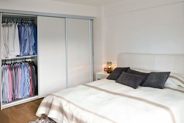 A full panel white glass panel bedroom wardrobe with anodised silver ...