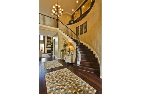 Nice A Spiral Staircase Serves As The Focal Point In This Grand Foyer, Invoking  A Sense