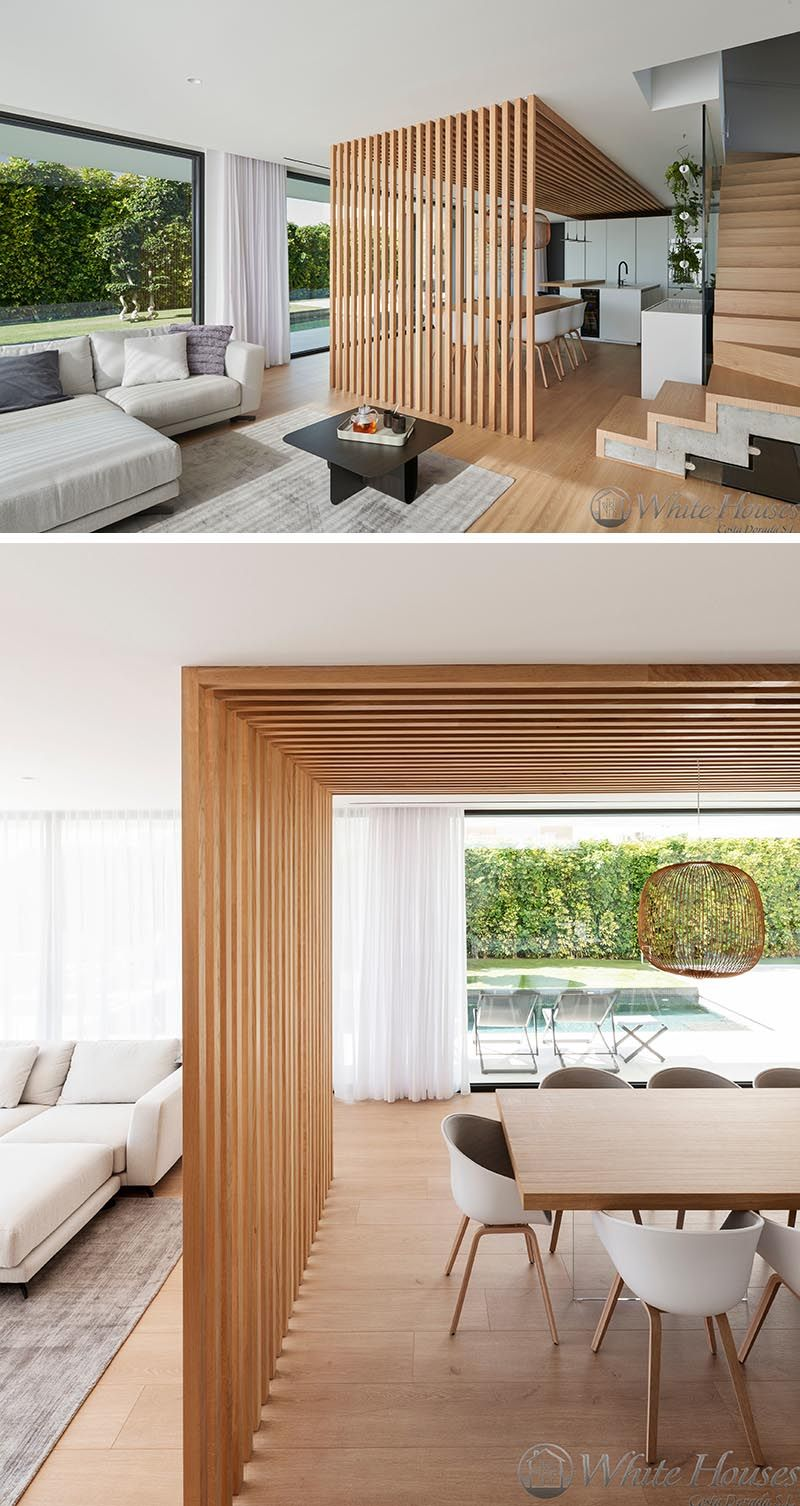 This Combined Kitchen And Dining Room Is Defined By An Overhead Wood Accent House Design House Interior Interior Design
