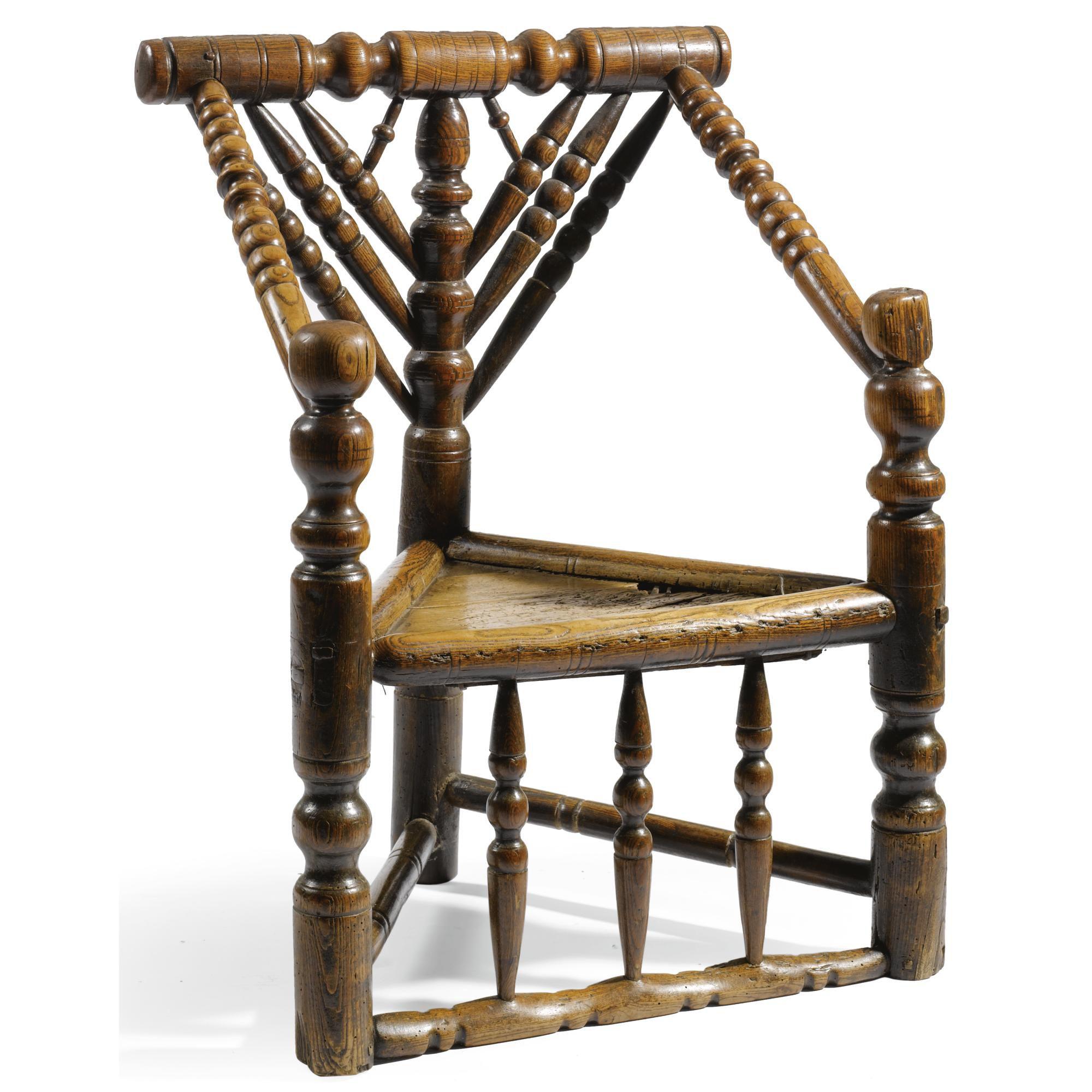 A Charles II turned ash child's armchair late 17th century  with boldly turned back rail, bobbin turned triform back support and boarded fruitwood triform seat, together with a later green velvet cushion