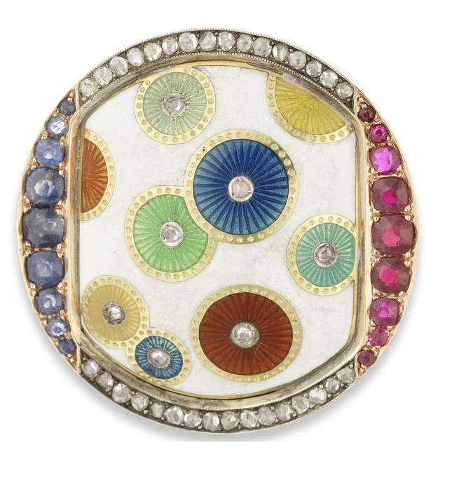 An aesthetic movement gem-set and enamel gold brooch. Fabergé, workmaster Henrik Wigström, St. Petersburg, circa 1900the central white opaque enamel plaque enriched with vari-colour overlapping diamond-centred enamel disks over guilloché ground within ruby, diamond and sapphire-set mount, with green leather presentation case stamped 'Fabergé, St. Petersburg, Moscow'
