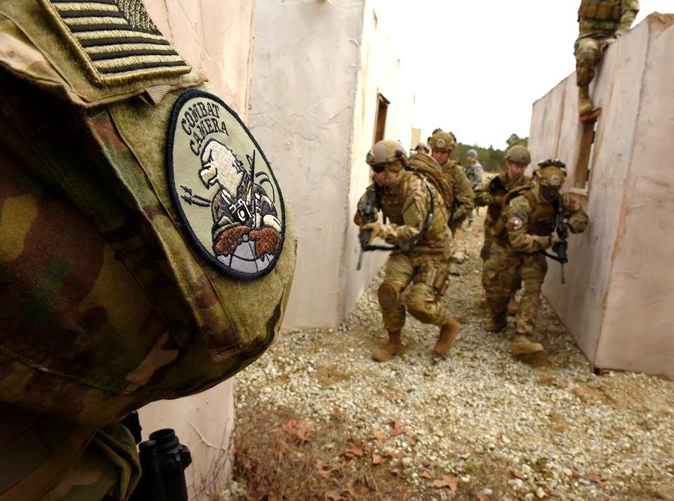 Combat Patch Worn On Right Shoulder Of Photographer