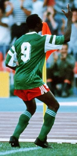 Roger Milla (Cameroon, 1973–1994, 102 caps, 28 goals) during the 1990 FIFA World Cup Italia quarter-final. He will always be remembered by football lovers for his original goal celebration with dancing belly rocking in the corner of the goal line.