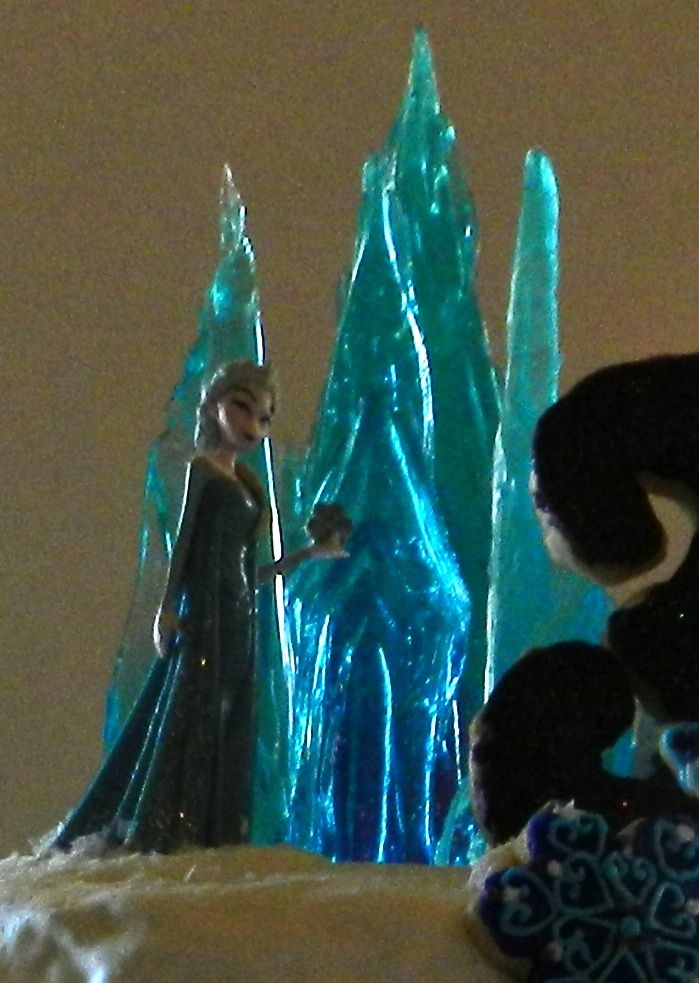 Frozen Cake Topper Closeup The sugar castle is lit with balloon