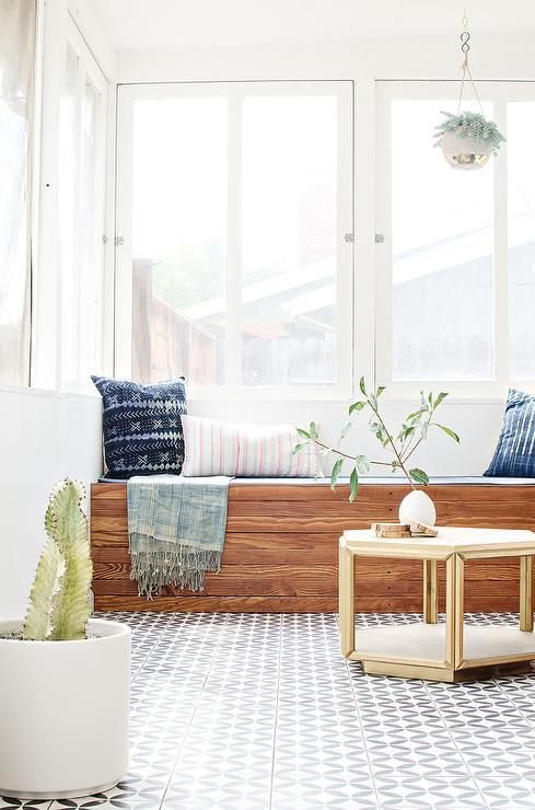 Sunroom Boasts A Built In Window Seat Bench Lined With Dark Blue