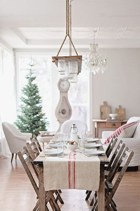 A dreamy white yet rustic Christmas table setting