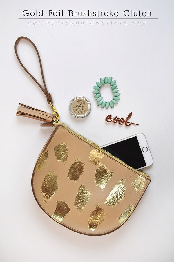 Create this simple #DIY and on trend Gold Foil Brushstroke Clutch! Delineateyourdwelling.com