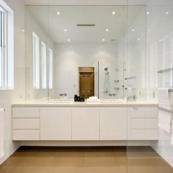 White vanity, modern bathroom, large mirror