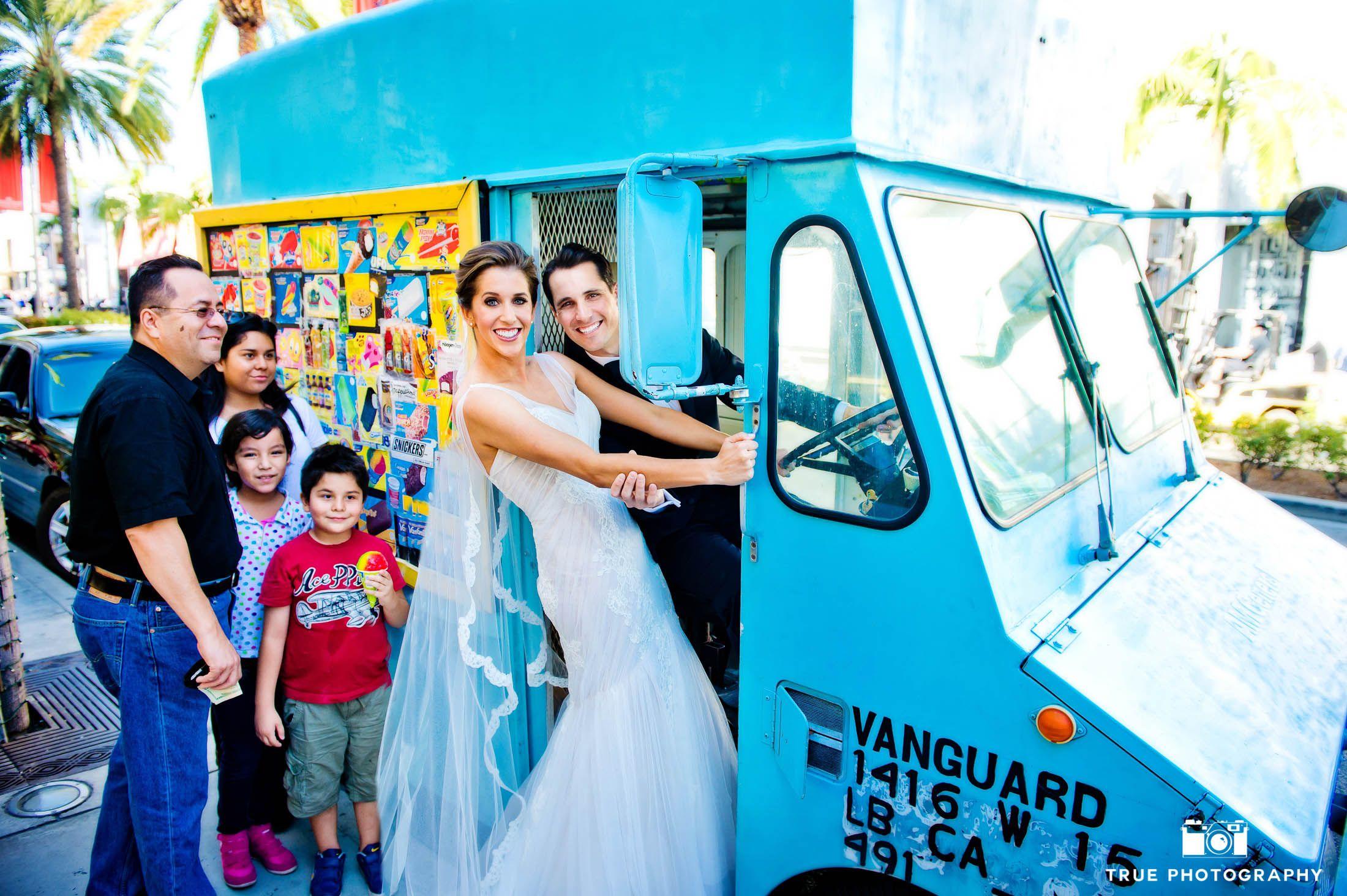 Bride and Groom stand in door of ice cream truck after wedding ...