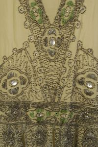 The Kent State University Museum collection includes over 400 dresses from the 1920s. These dresses include some marvelous examples of embroidery, beadwork and fringe. In order to showcase the dept…