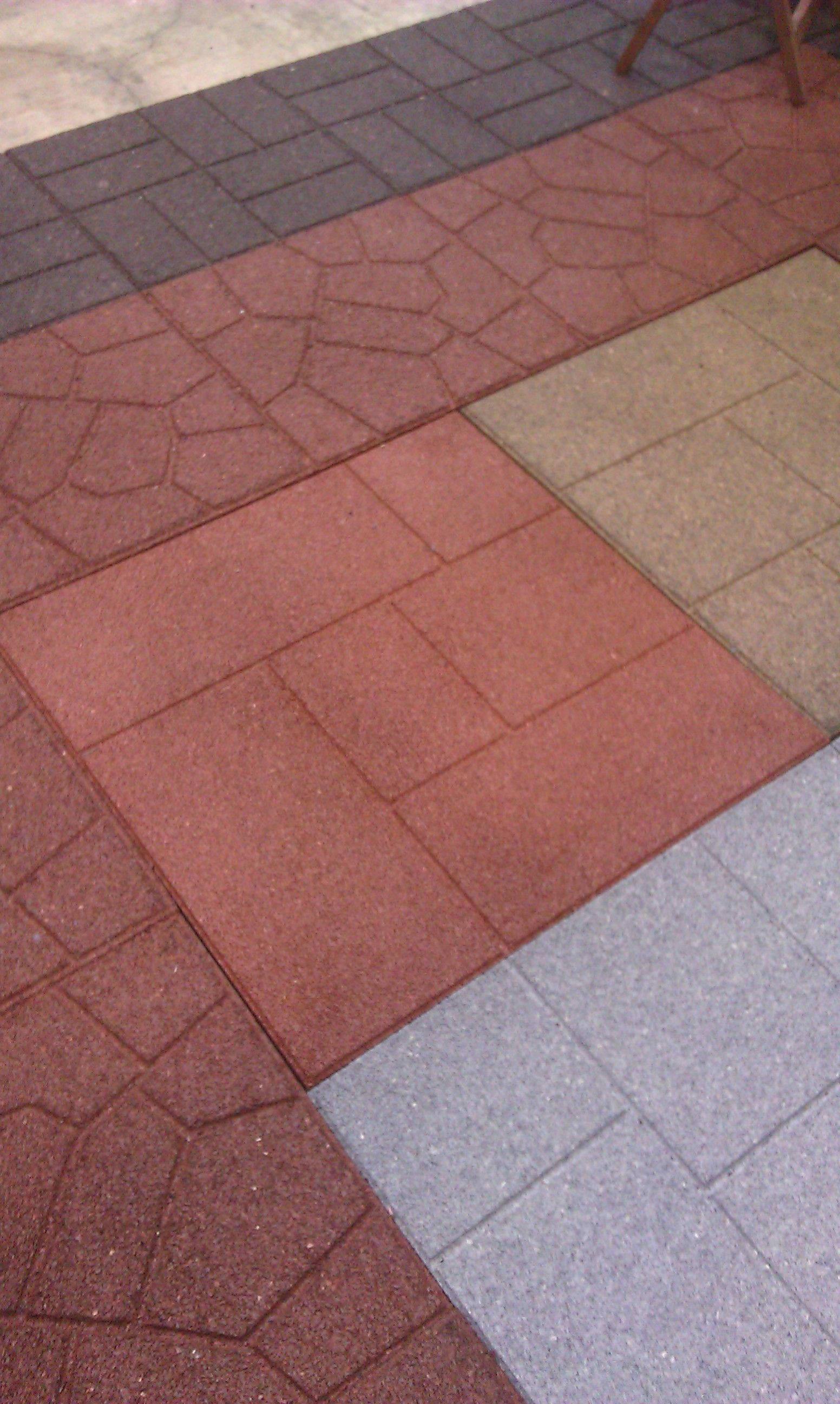 100% recycled rubber flooring tiles add long lasting beauty to an
