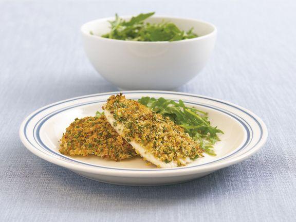 Probieren Sie die leckeren Fischfilets mit Parmesankruste von EAT SMARTER oder eines unserer anderen gesunden Rezepte!