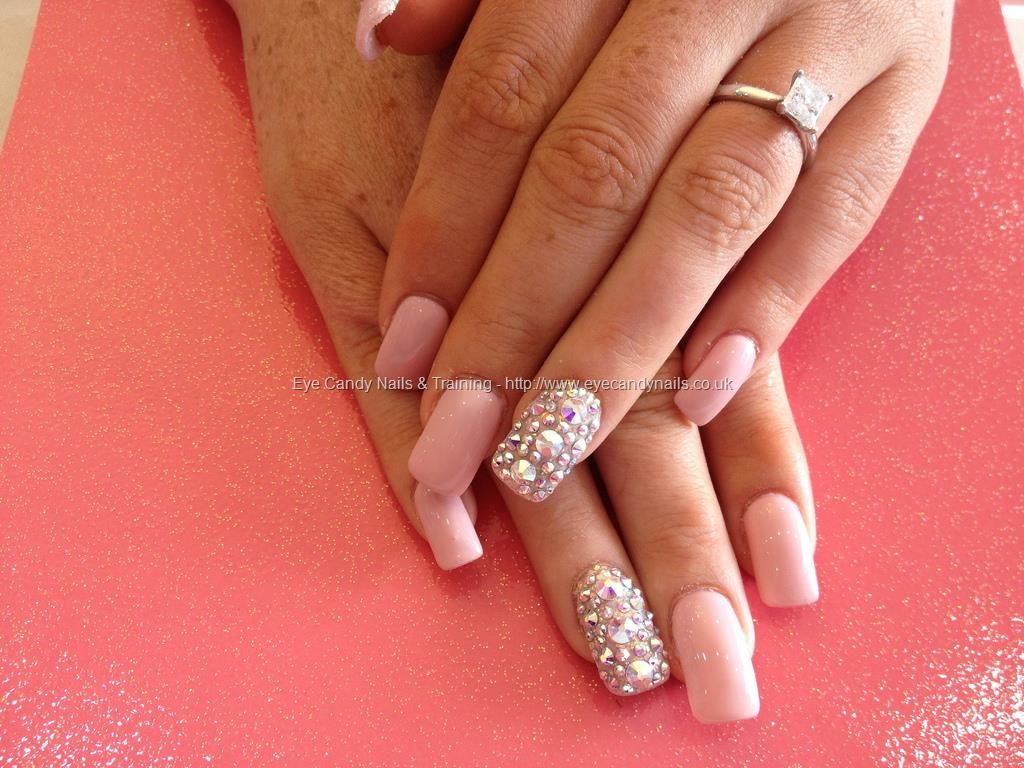 Acrylic+nails+with+nude+gel+polish+and+Swarovski+crystals+on+ring+finger