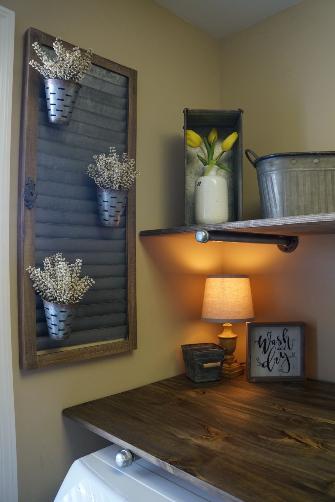 How To Do A Weekend DIY Laundry Room Mini Makeover Using Rustic Industrial Pipe Shelves And Cute Farmhouse Decor All On Budget Of Less Than 250