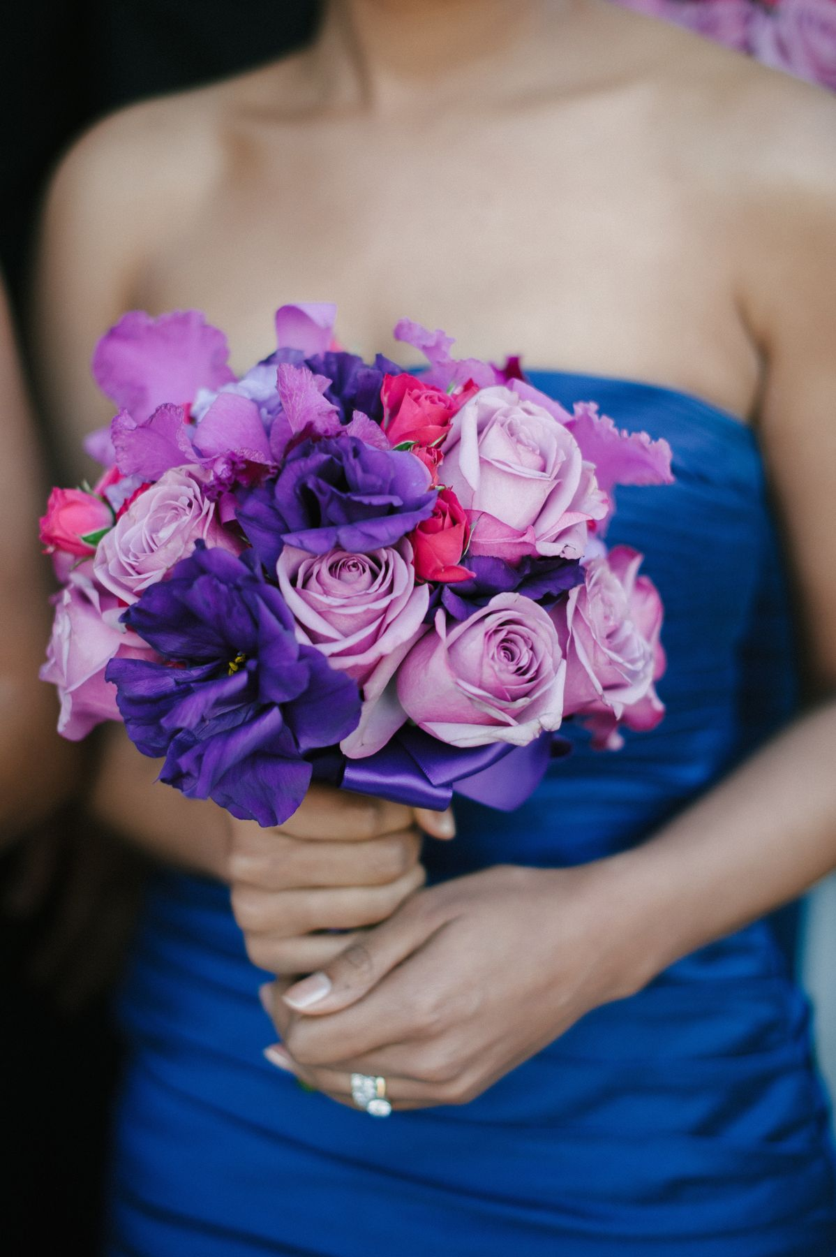 Bridesmaids, who were dressed in strapless royal blue gowns, carried vibrant arrangements of royal purple blooms as well as lavender and pink roses. Photography: Amy & Stuart Photography. Read More: http://www.insideweddings.com/weddings/vibrant-purple-blue-celebration-at-union-station-in-los-angeles/580/