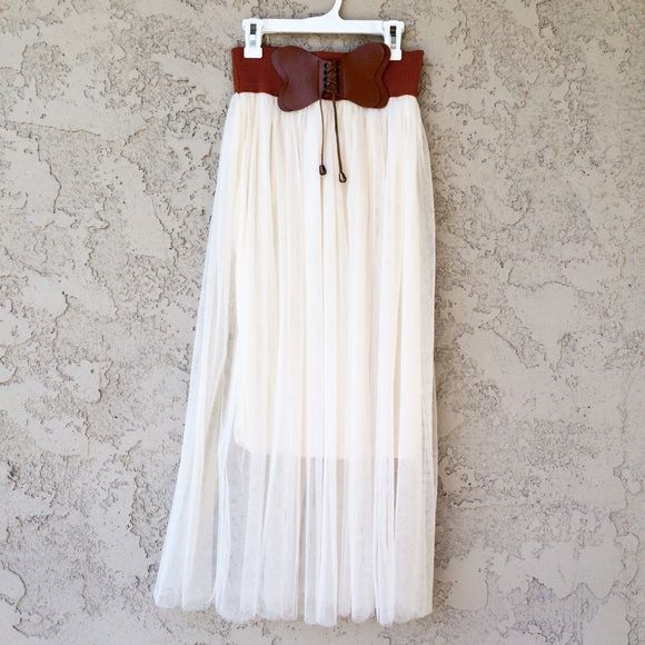 Japanese Boho Maxi Skirt Beautiful cream colored maxi skirt with a brown stretchy waist Size: XS (fits a 24 inch waist and up) Purchased from a kawaii Japanese store and wore once, not my style anymore NO TRADES PRICE IS FIRM Skirts Maxi