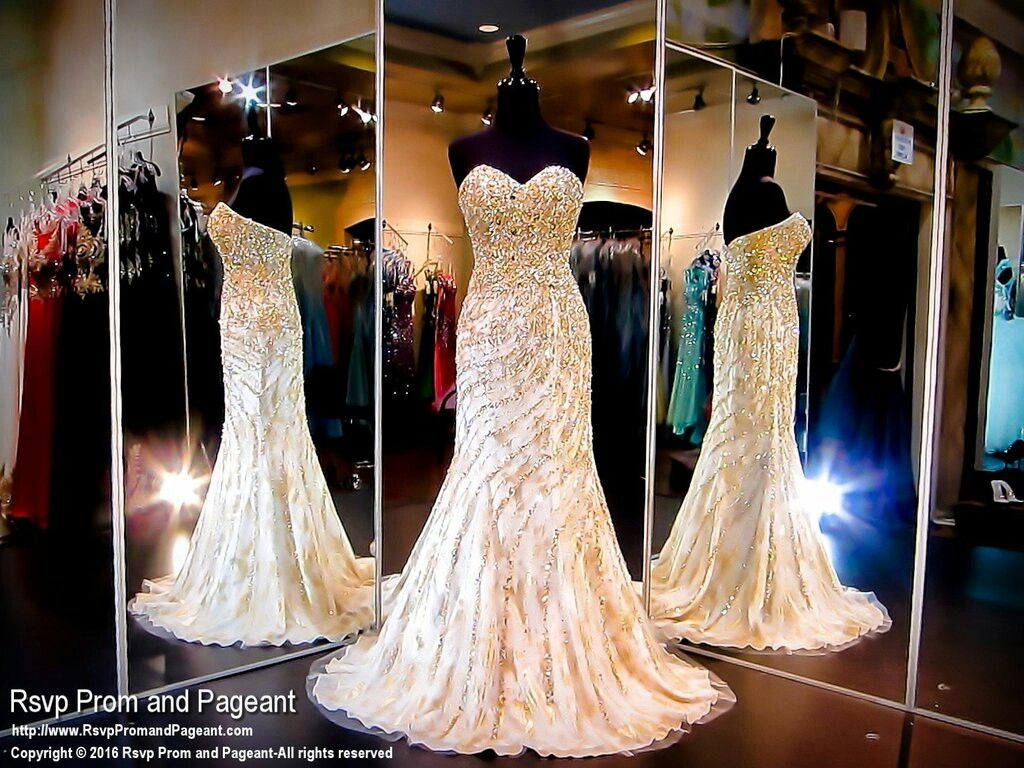 Beautiful gold whirled embellishment on cream mermaid prom dress