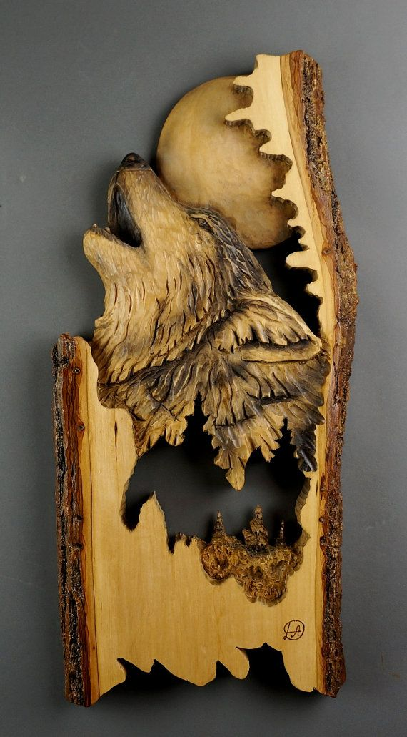 Wolf Carved on Wood Wood Carving with Bark Hand Made Gift Wall Hanging for the Wolves lovers Rustic OOAK Gift for a Hunter Cabin Deco THIS SCULPTURE IS AVAILABLE BY ORDER. Approximate dimensions: 11 X 24 X 1,5 (29cm X 61cm X 4 cm) Please contact me if you need a different size The end result may be slightly different from pictures, because its impossible to find the identical peace of wood , the sculpture is carved and painted by hand, and it is impossible to obtain an identical sculpture...