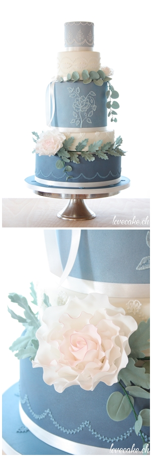 Blue White Wedding Cake With Royal Icing Detail And Sugar Flowers