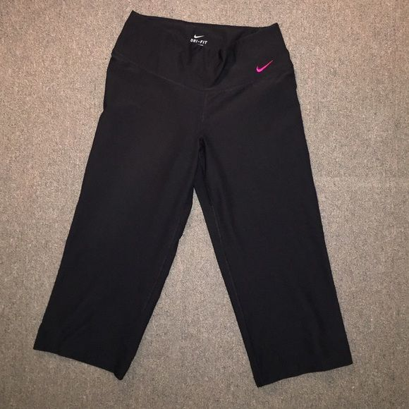 Nike Dri fit work out capris Black Nike Dri fit work out capris. Size small. Pink embroidered check on front and pink detailing on back. Worn a few times. In good condition - no fading. Nike Pants