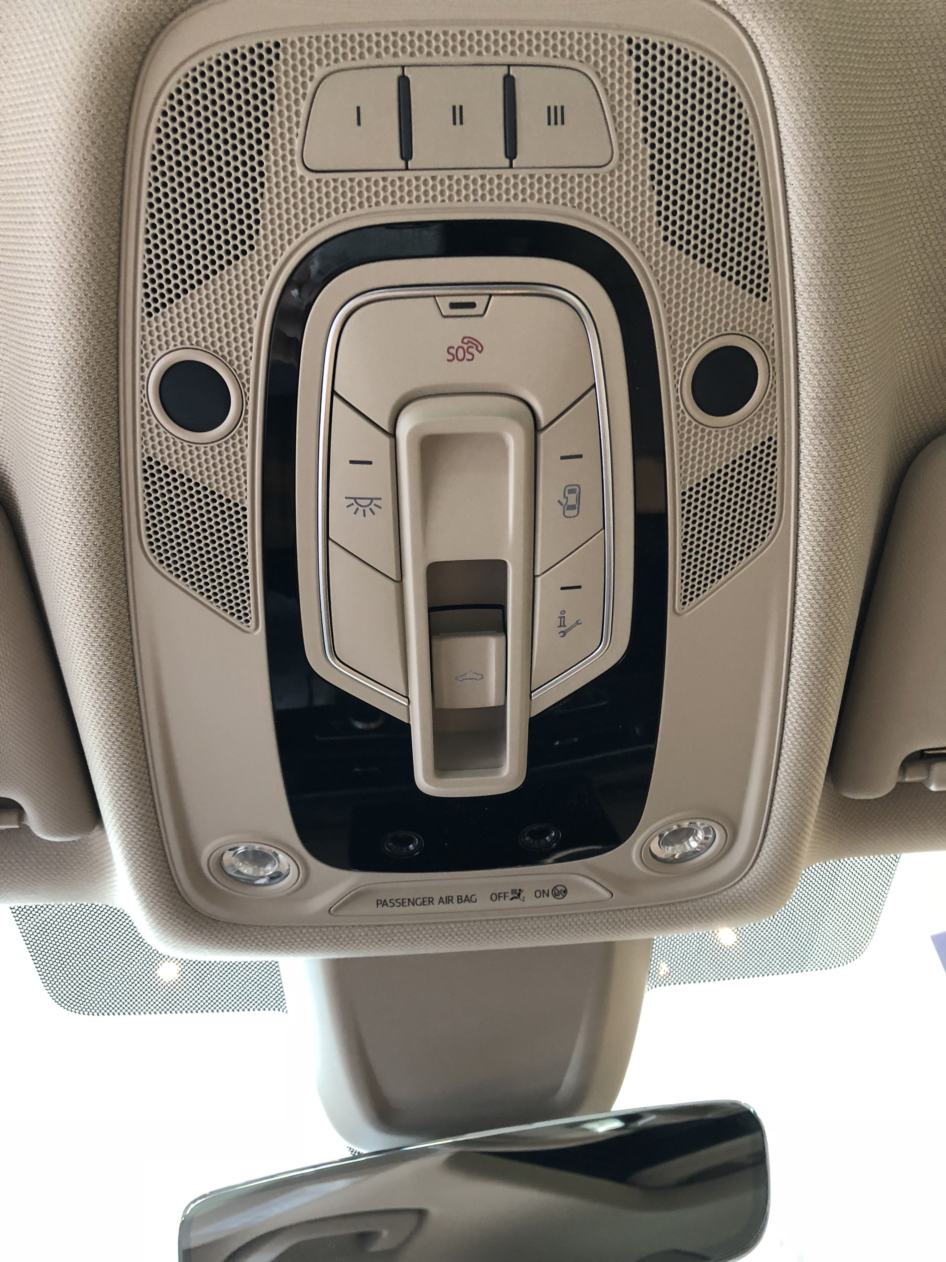 View of moon roof and interior light control panel on tan interior