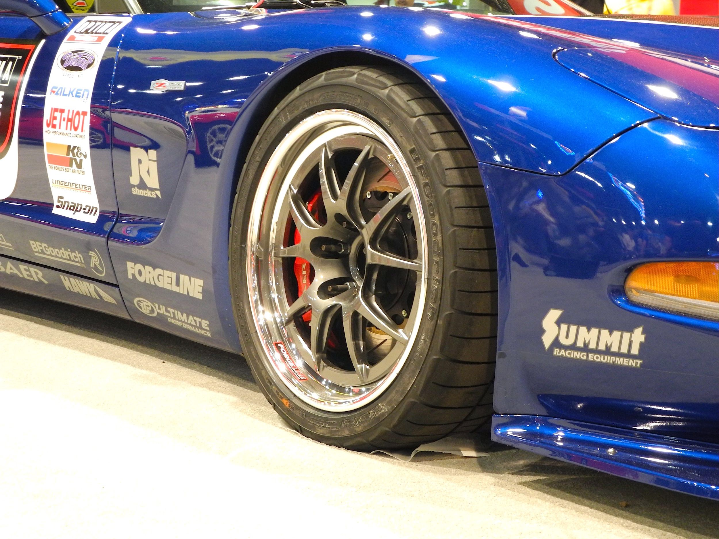 Danny Popp S Ousci Winning C5 Z06 At Champion S Corner In The Optima Batteries Booth At The 2015 Sema Show This Lingenfelter Rocket Ride Corvette Sema 2015