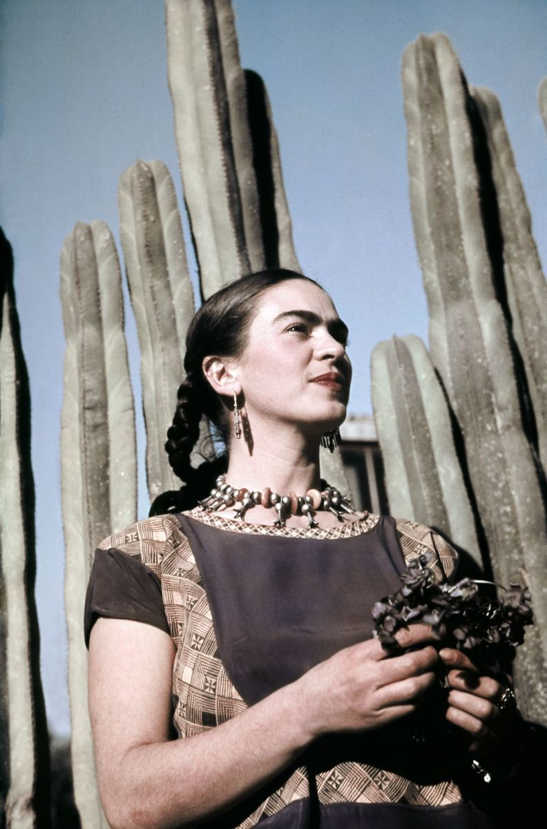 Frida Kahlo and the cactus wall at her San Angel house. Photograph Ivan Dmitri / Michael Ochs Archives / Getty