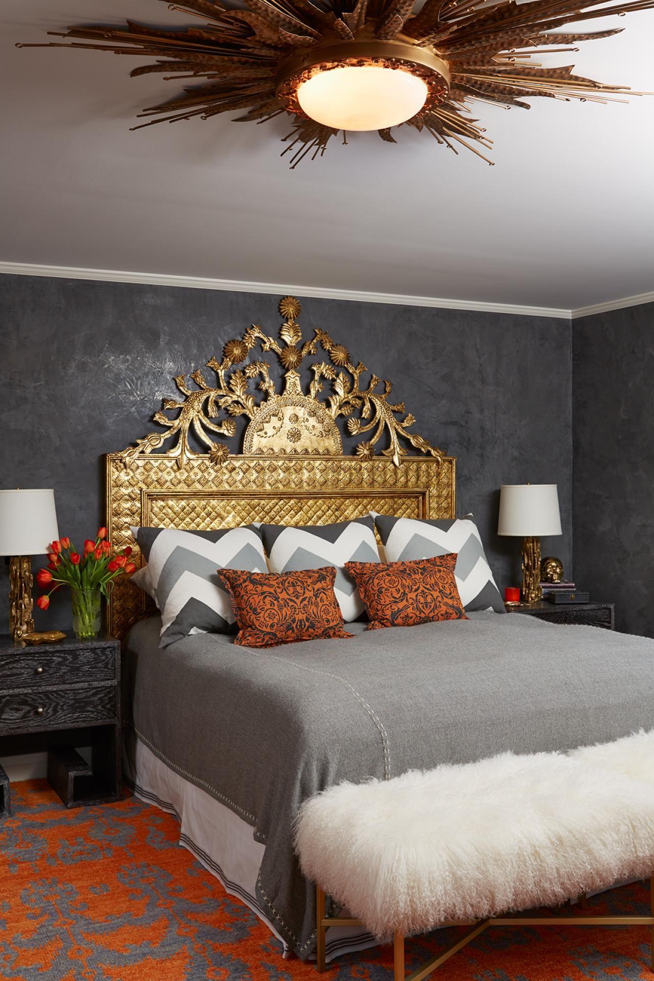 An Ornate Gold Headboard And Sunburst Light Fixture Create A
