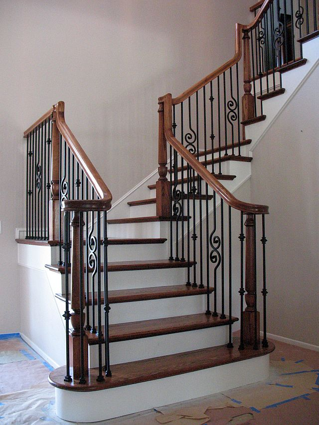 Mr.Gills Construction | Custom Stairs | Metal & Wood Balusters